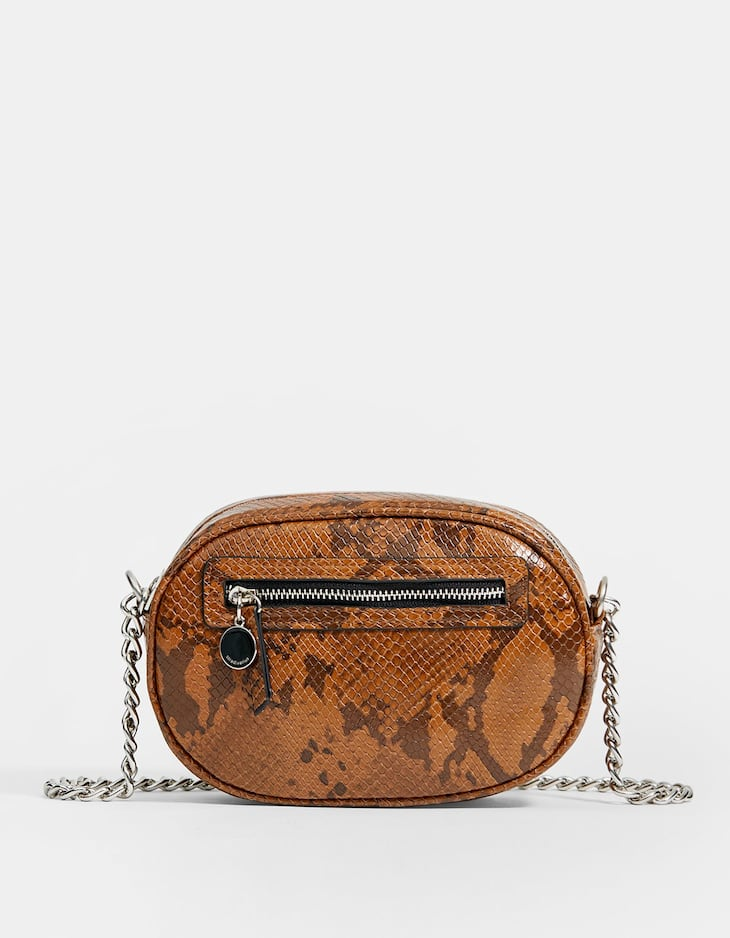 Oval-shaped snakeskin print crossbody bag