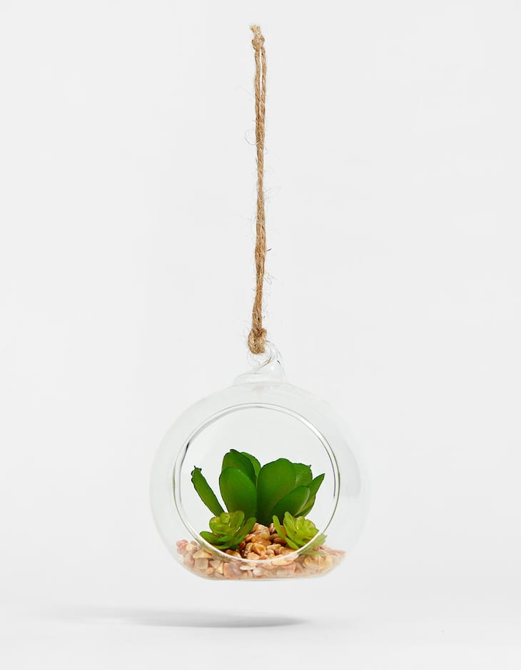 Fake plant in glass