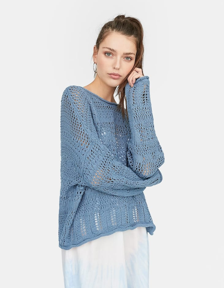 Open knit sweater with scalloped hem