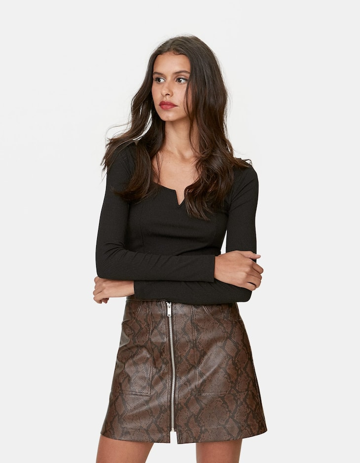 Faux leather snakeskin skirt.