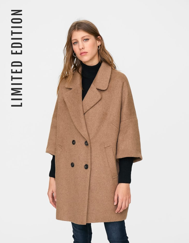 Cloth coat with chunky knit sleeves
