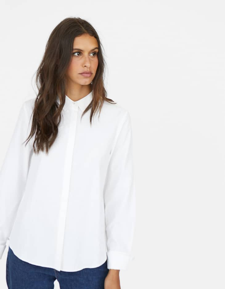 Shirt with metal button on the collar