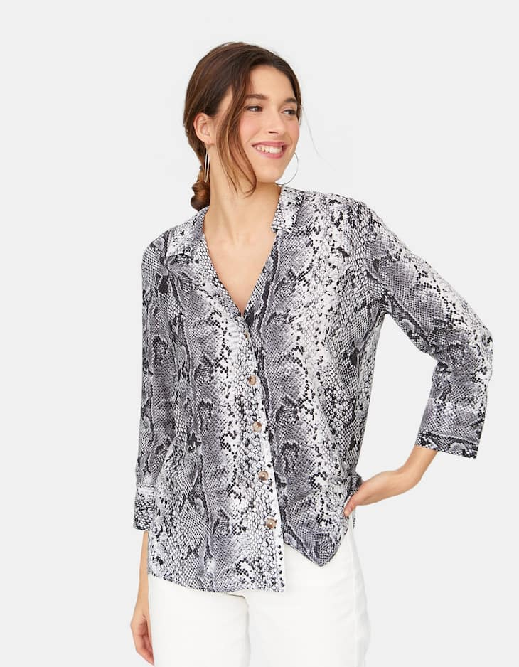 Shirt with snakeskin print neckline