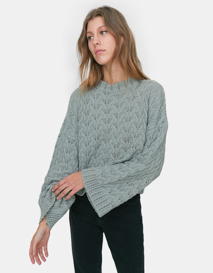 Cropped open knit sweater with wide sleeves