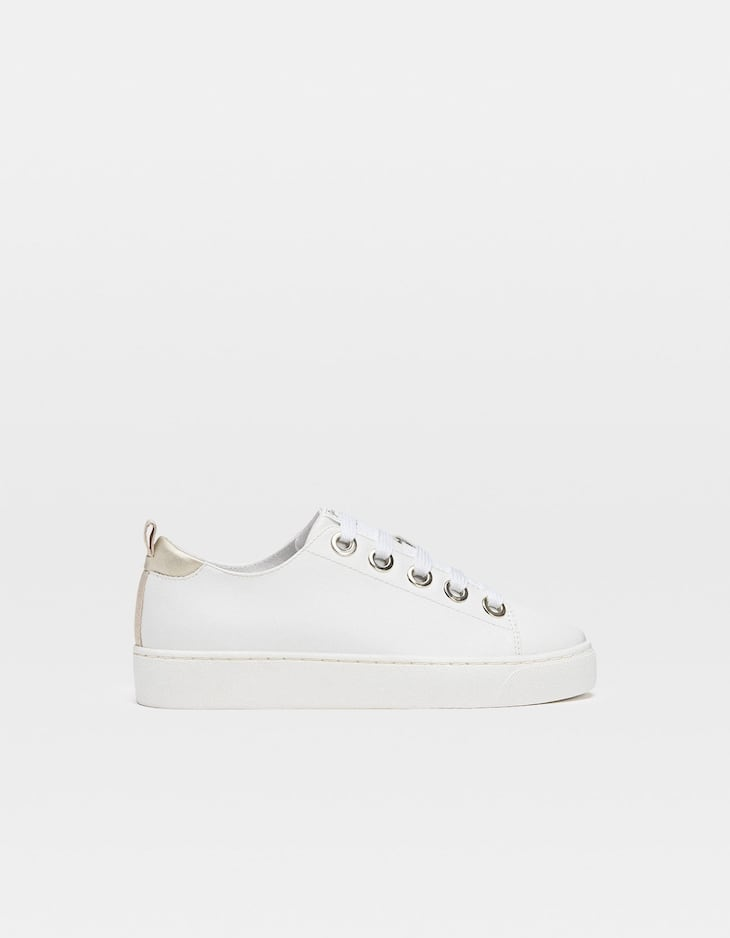 White trainers with heel piece detail