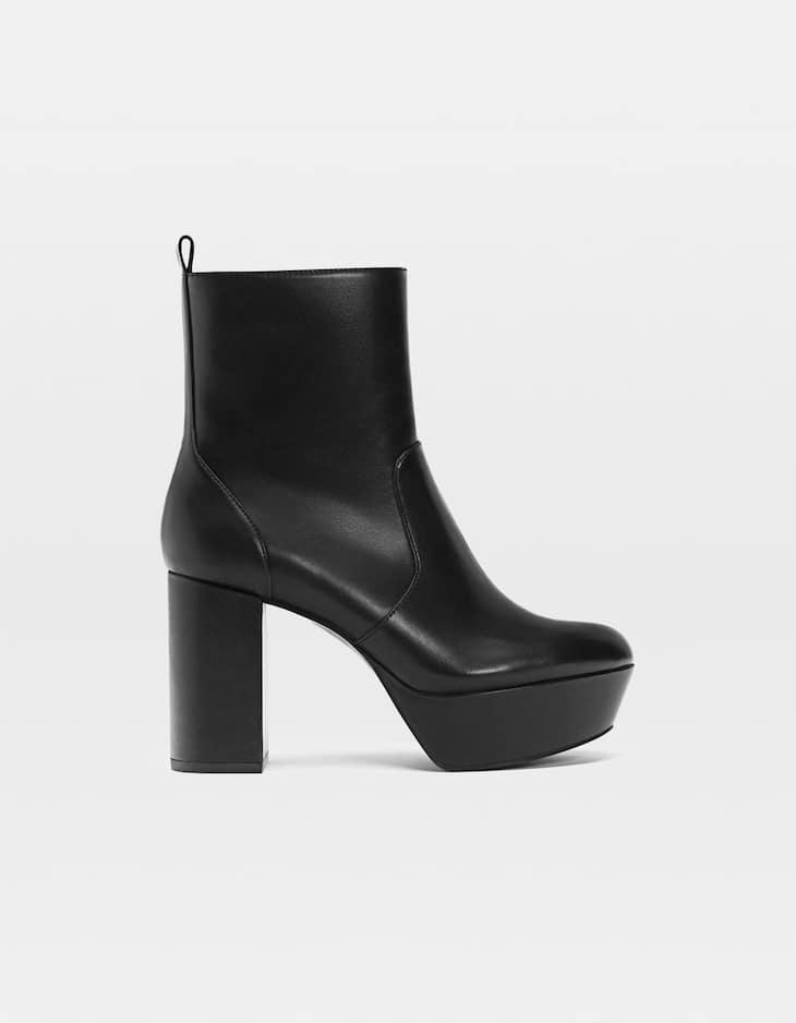 Black platform heel ankle boots