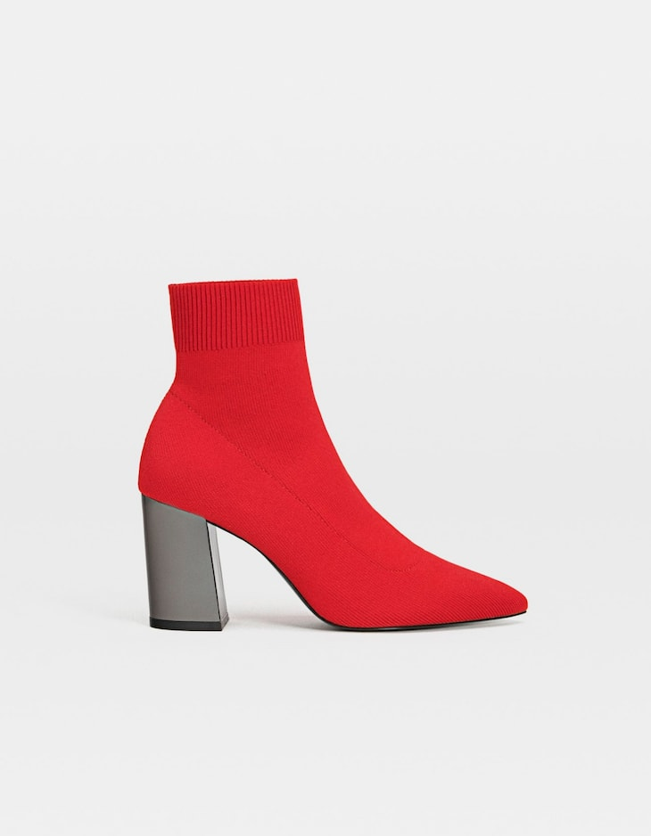 Red sock-style high heel ankle boots