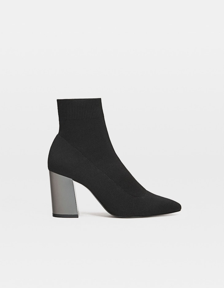 Black sock-style high heel ankle boots