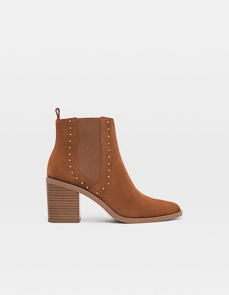 Tan leather high-heel ankle boots with studs