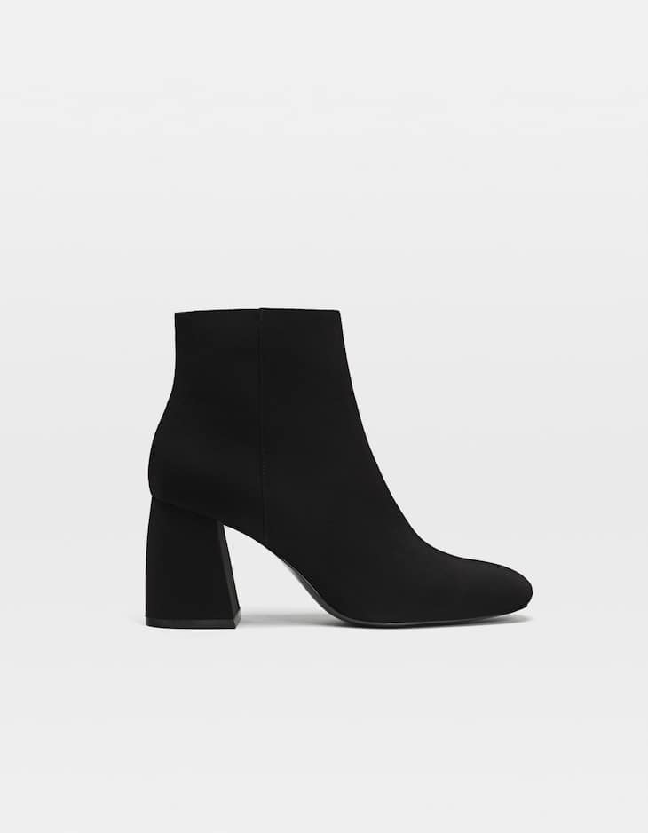 Black heeled ankle boots with zip detail