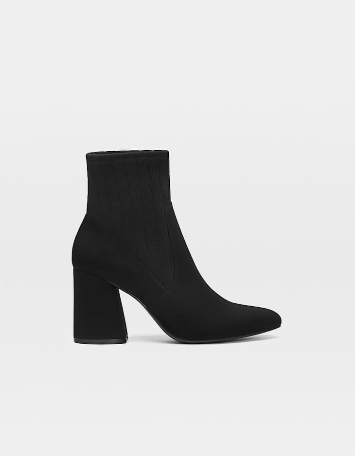 Heeled ankle boots with contrasting sock detail