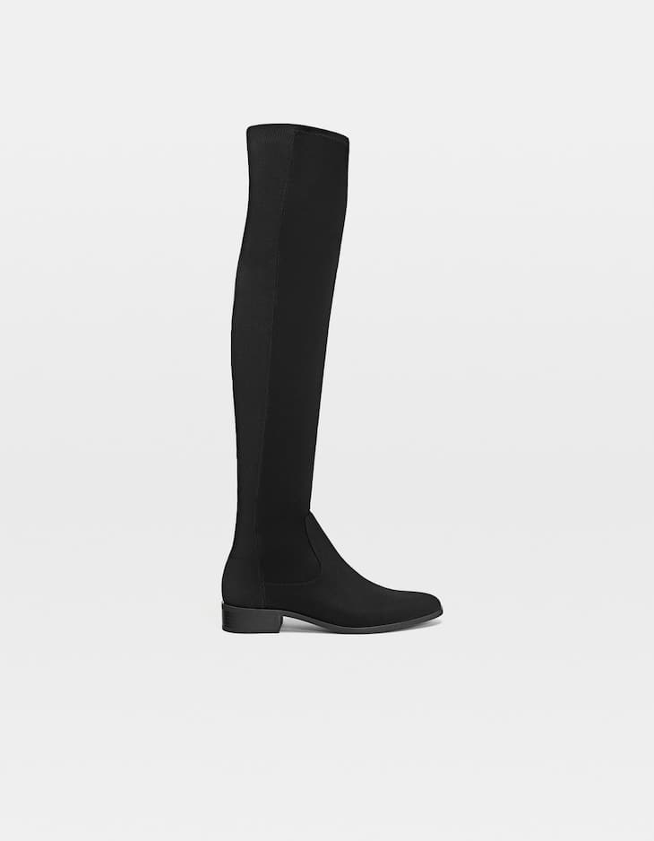 Black flat over-the-knee boots in stretch fabric