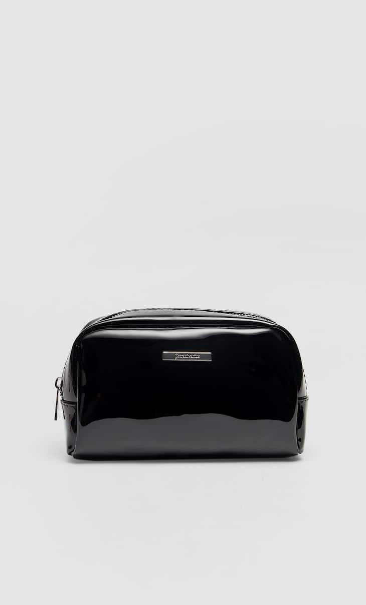 Patent finish toiletry bag