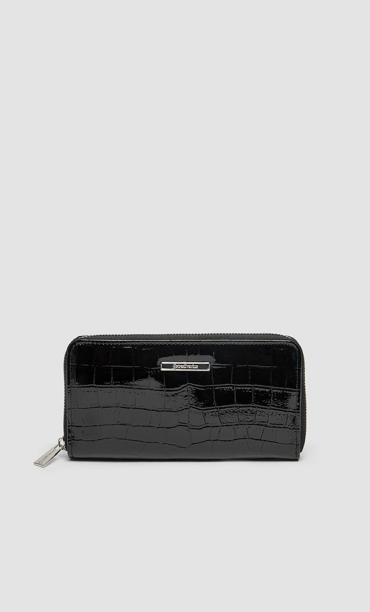 Faux patent leather wallet with a zip fastening