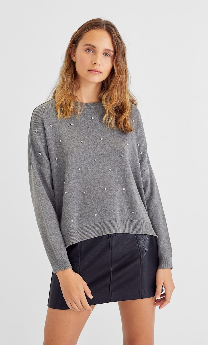 Sweater with appliqués