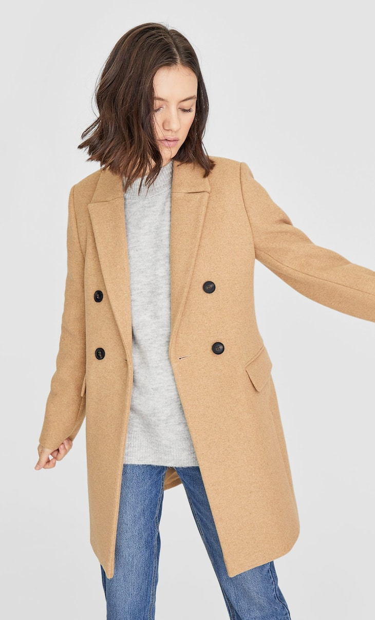 Double-breasted woolly fabric coat
