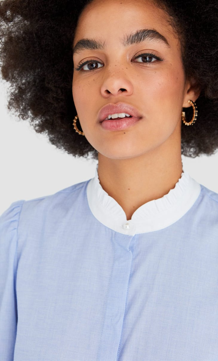Blouse with a Victorian collar