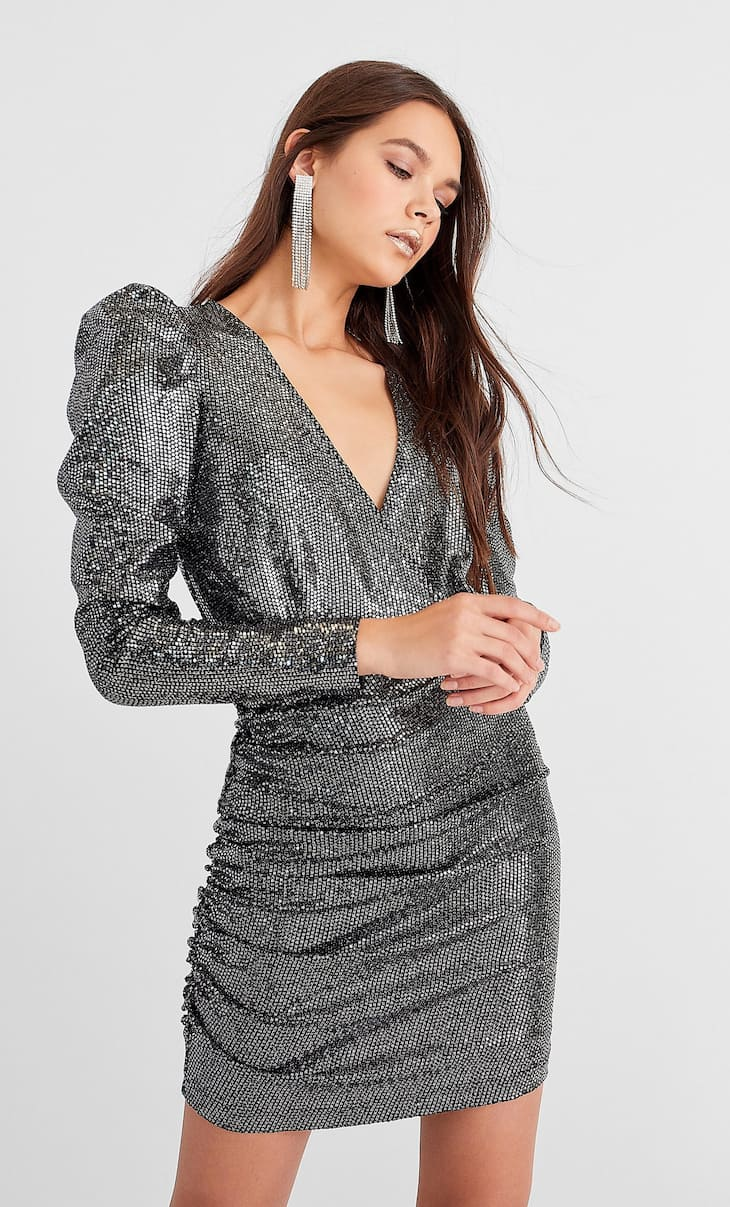 Sequinned dress with puff sleeves