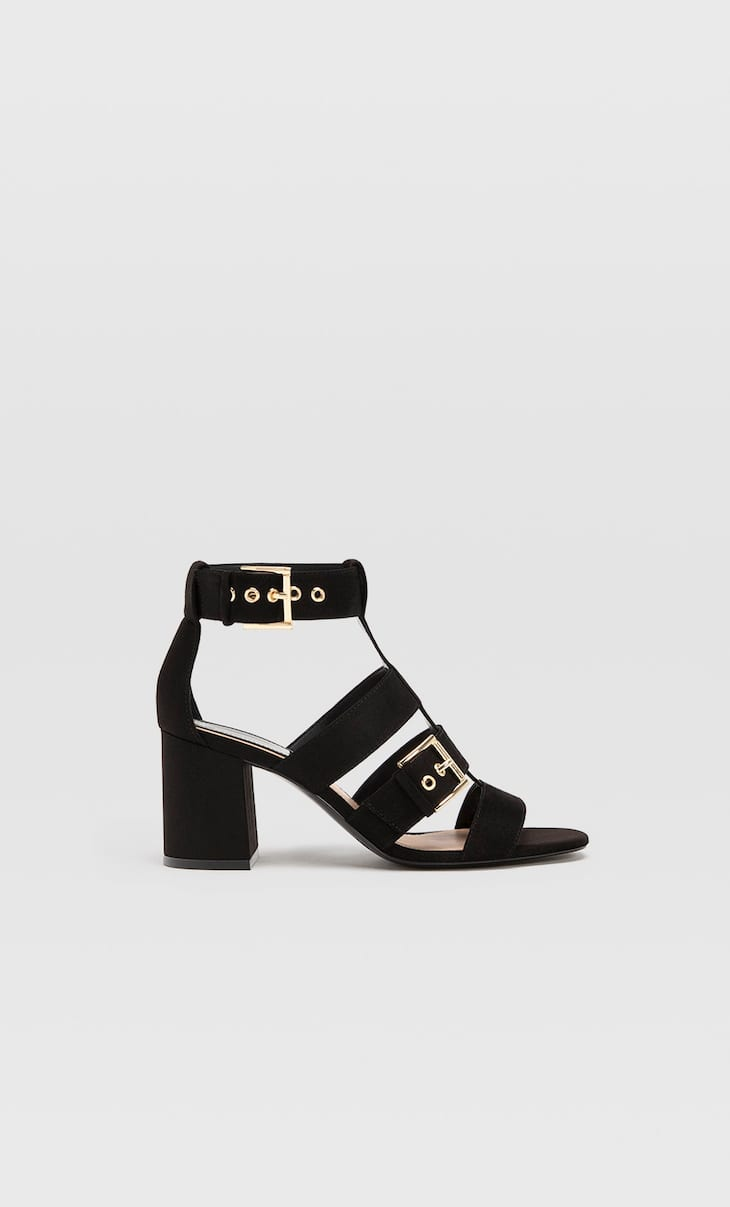 Black high-heel sandals with buckles