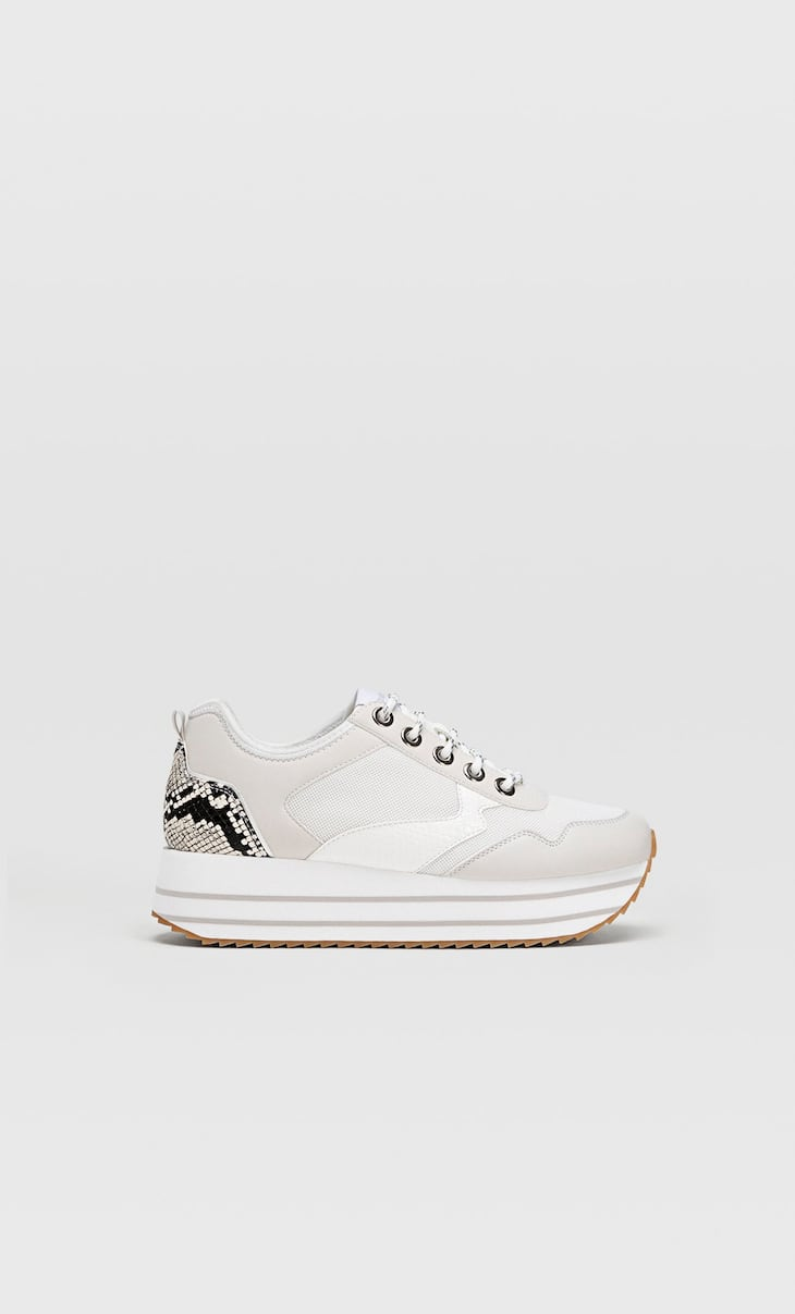 White platform trainers with heel piece detail