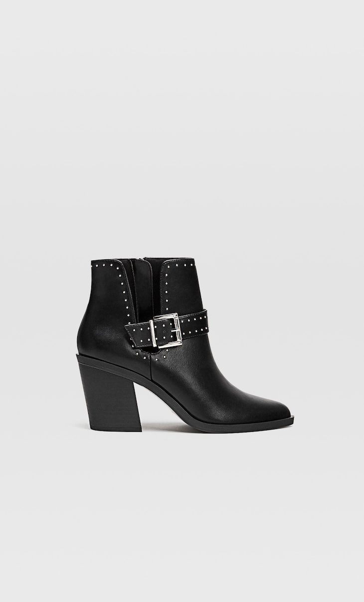 Ankle boots with cut out heels and buckles
