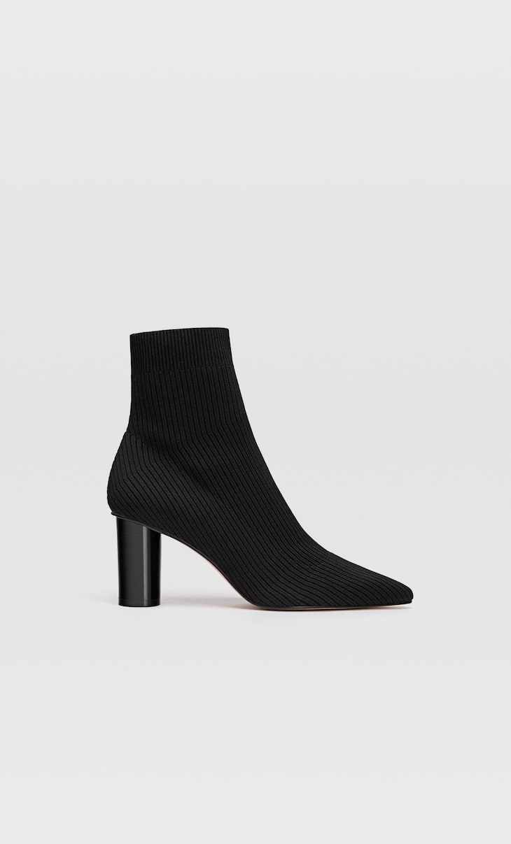 Black fabric sock-style high heel ankle boots