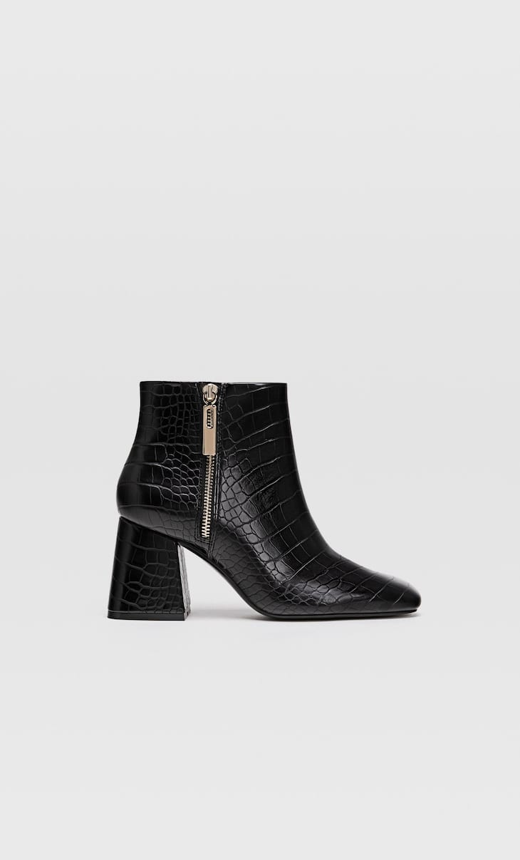 Black embossed high heel ankle boots