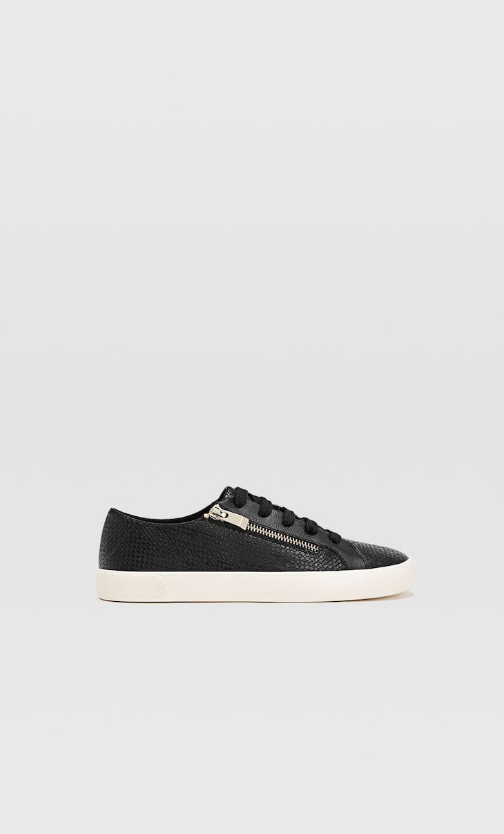 Black trainers with zip detail