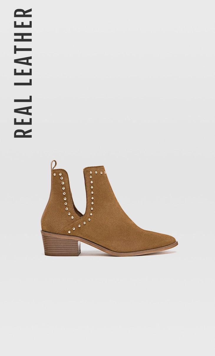 Mid-heel cut out leather ankle boots with studs