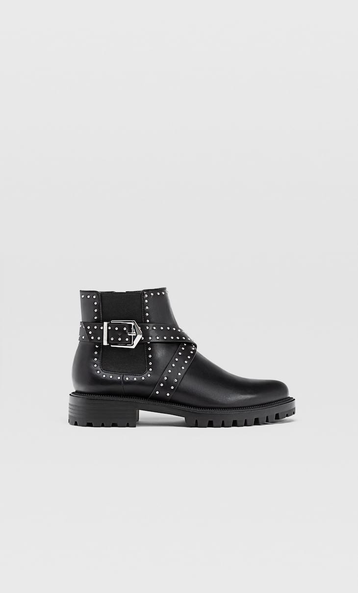 Ankle boots with track soles and studs