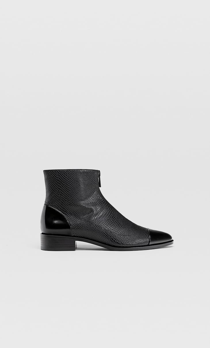Embossed flat ankle boots with detailing on the toes