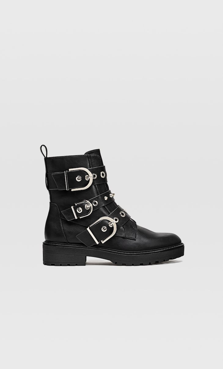Flat ankle boots with buckle details