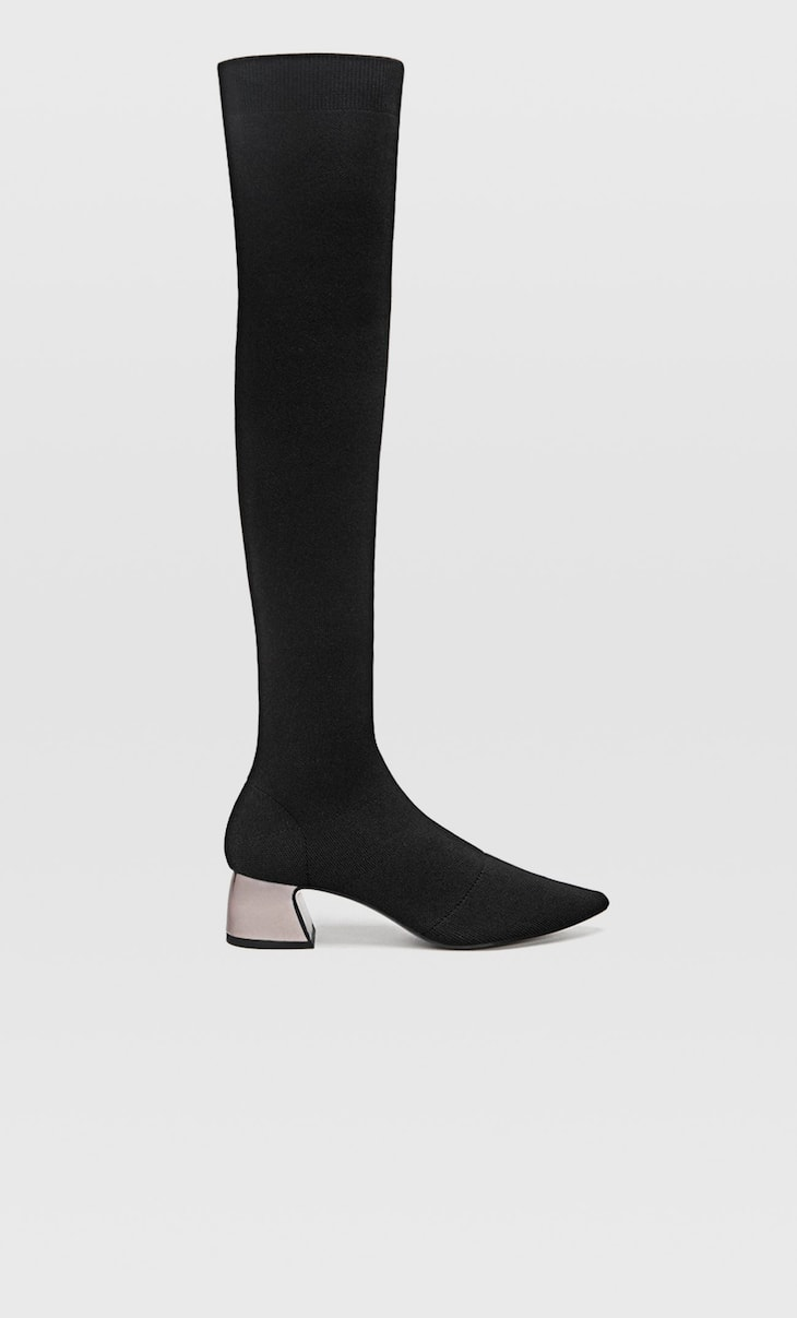 Black elastic heeled boots
