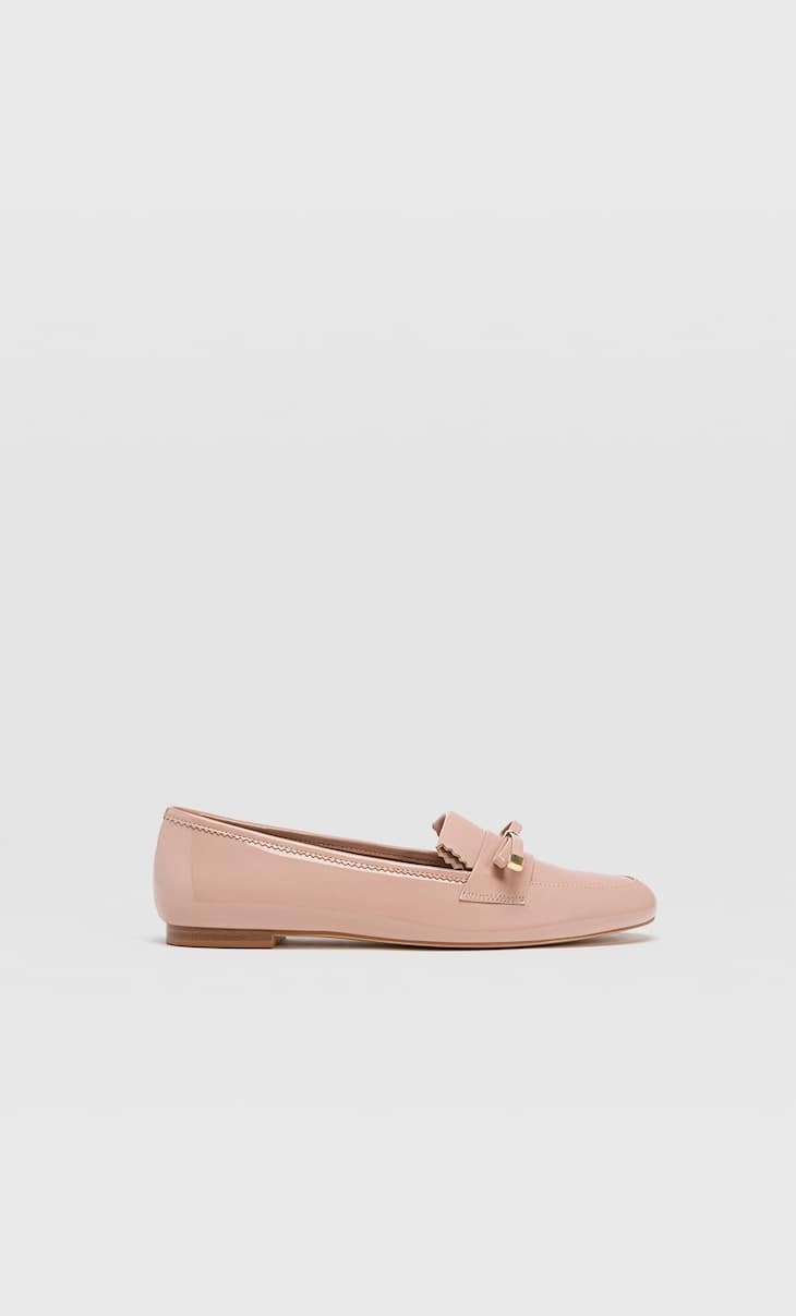 Pink loafers with bow detail