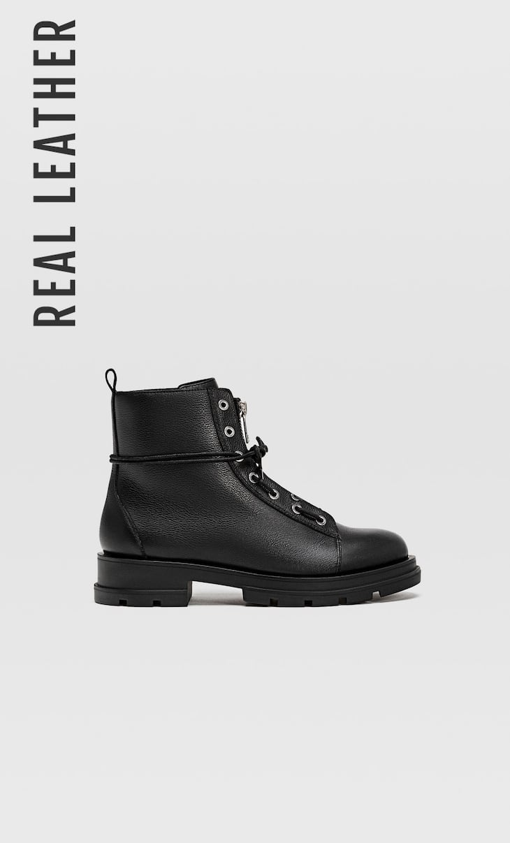 Black zip-up track sole leather ankle boots