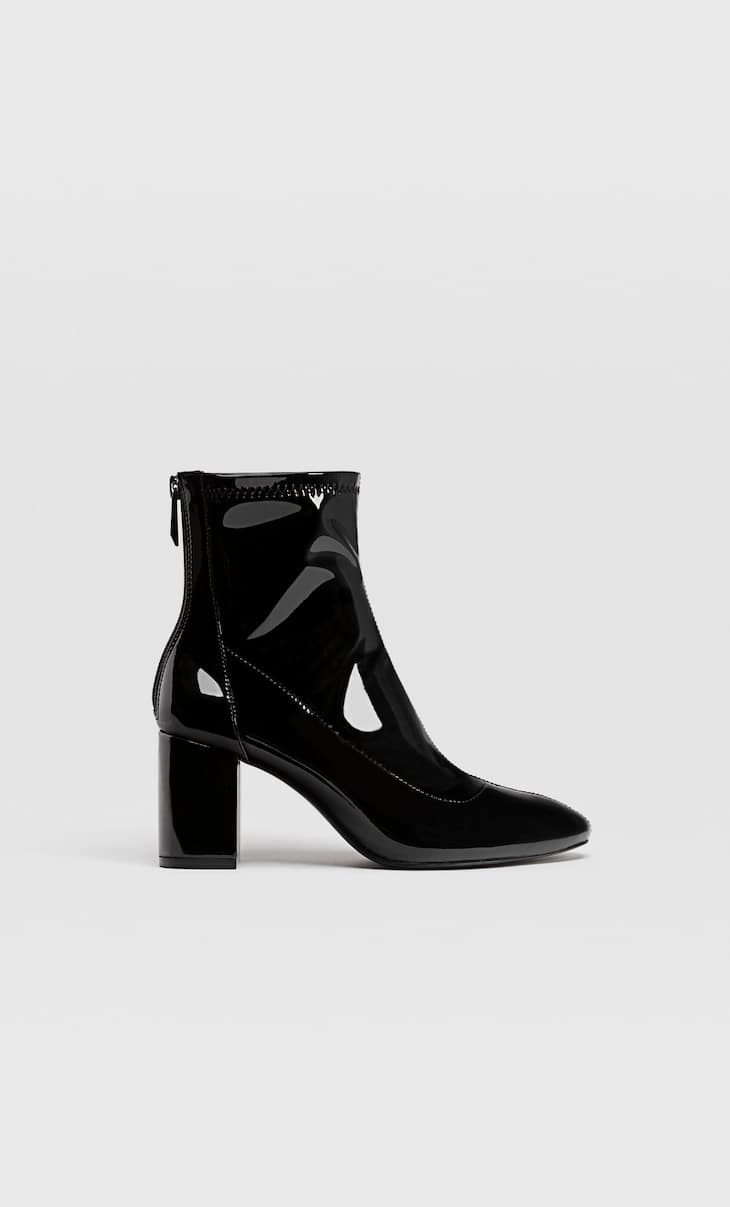 Black heeled faux patent leather ankle boots