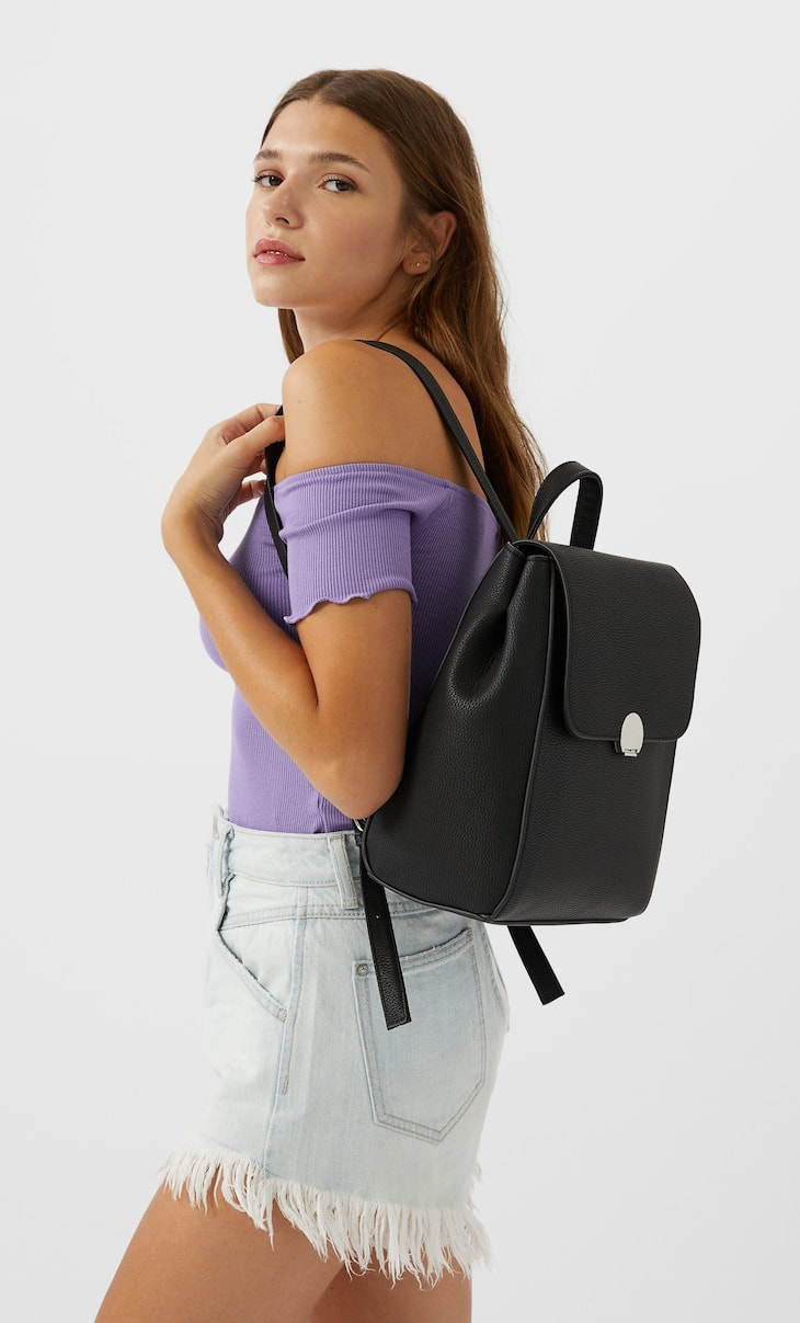 Backpack with turn lock clasp