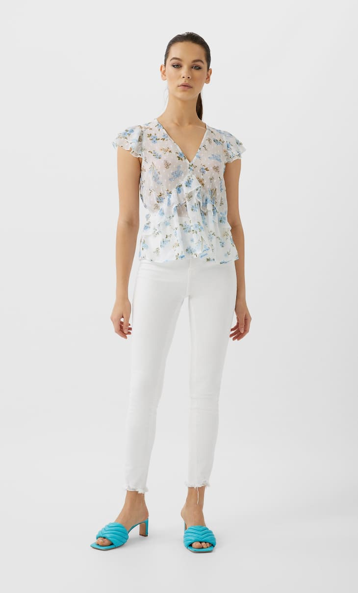 Ruffled flowing dotted mesh top