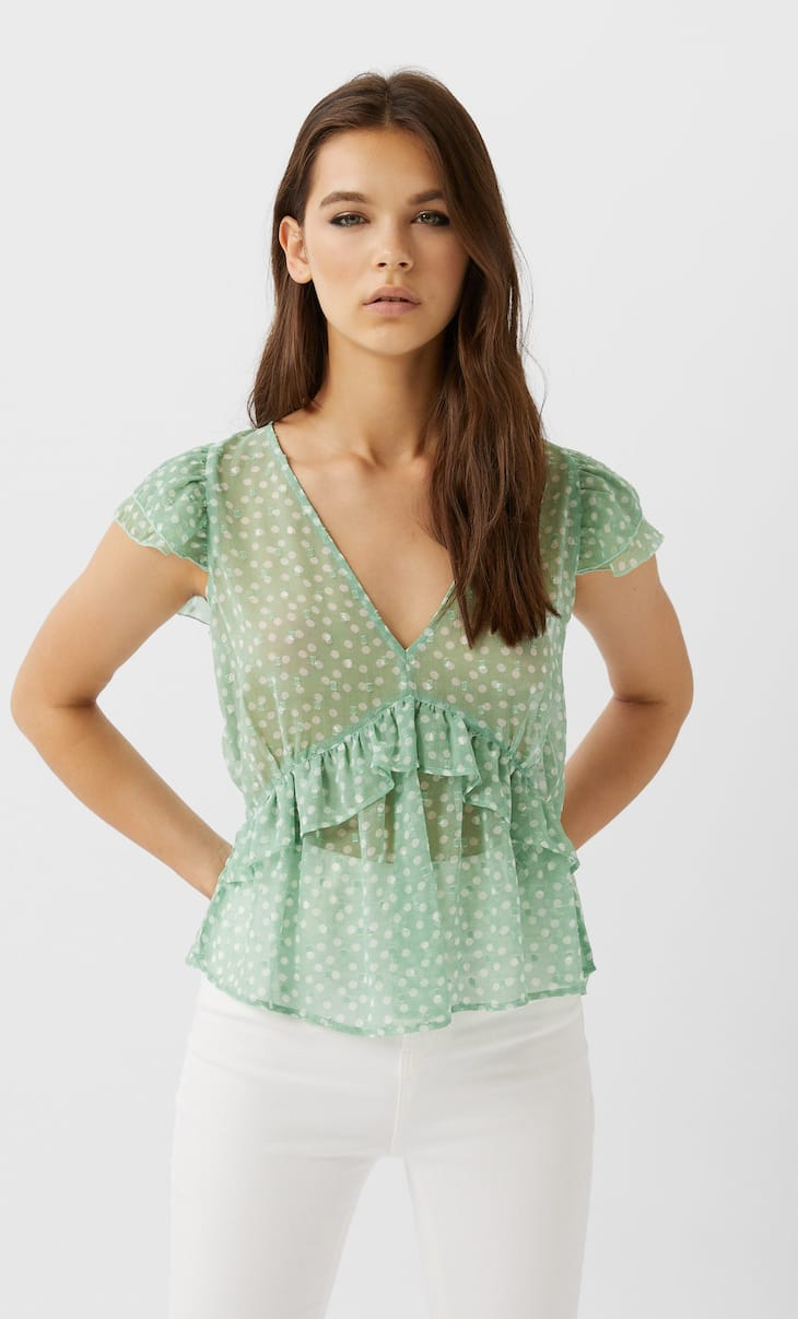 Ruffled flowing top featuring large polka dots