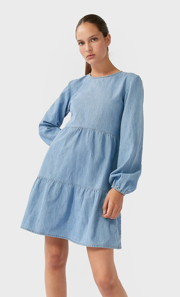 Short denim dress with ruffled hem