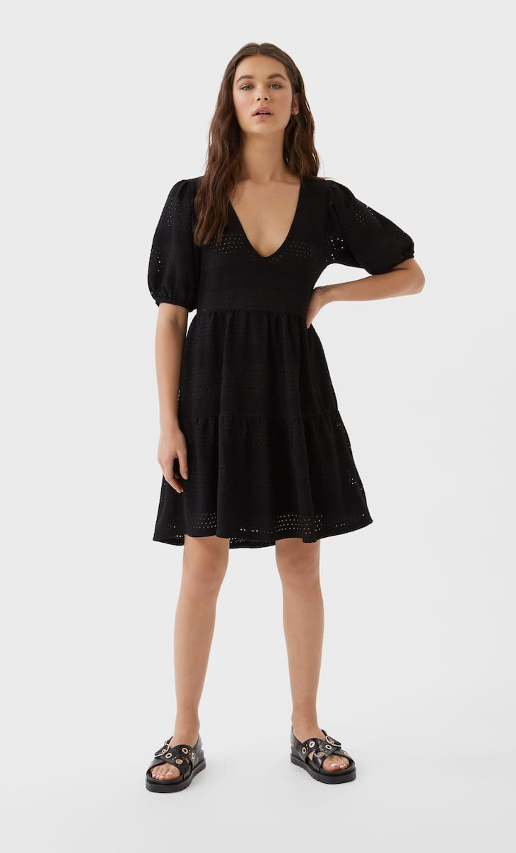 Short knit dress featuring embroidery