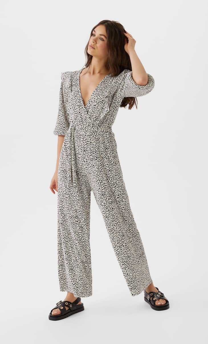 Pleated print jumpsuit featuring ruffles