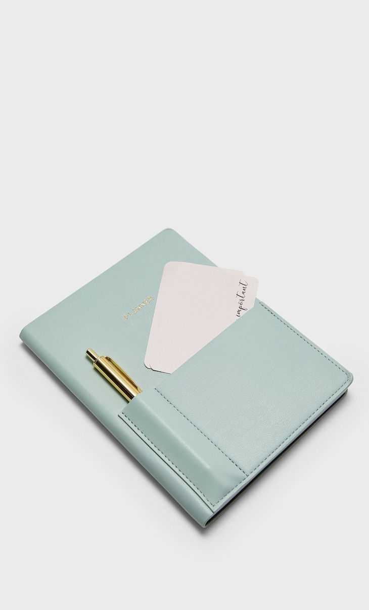 Planner with golden pen