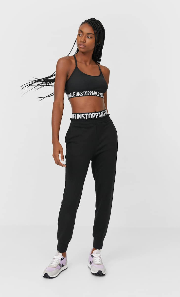 Joggers with slogan