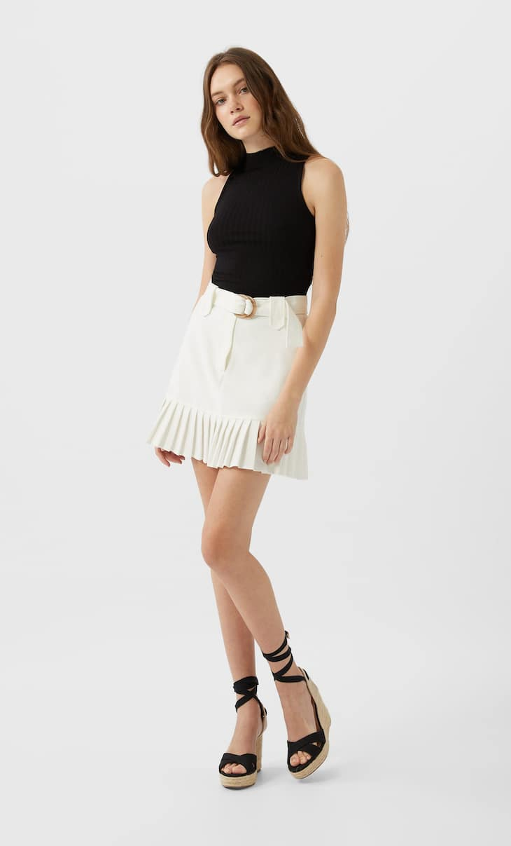 Mini skirt with pleated hem
