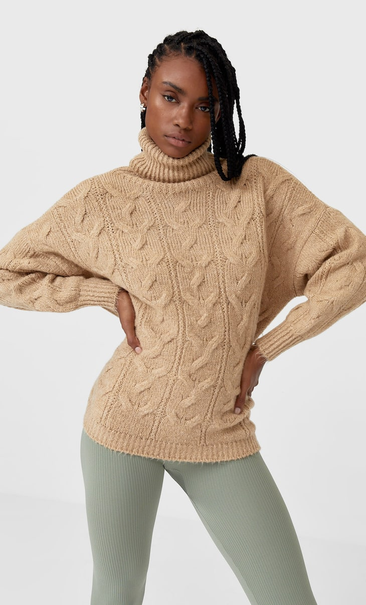Felted cable knit sweater