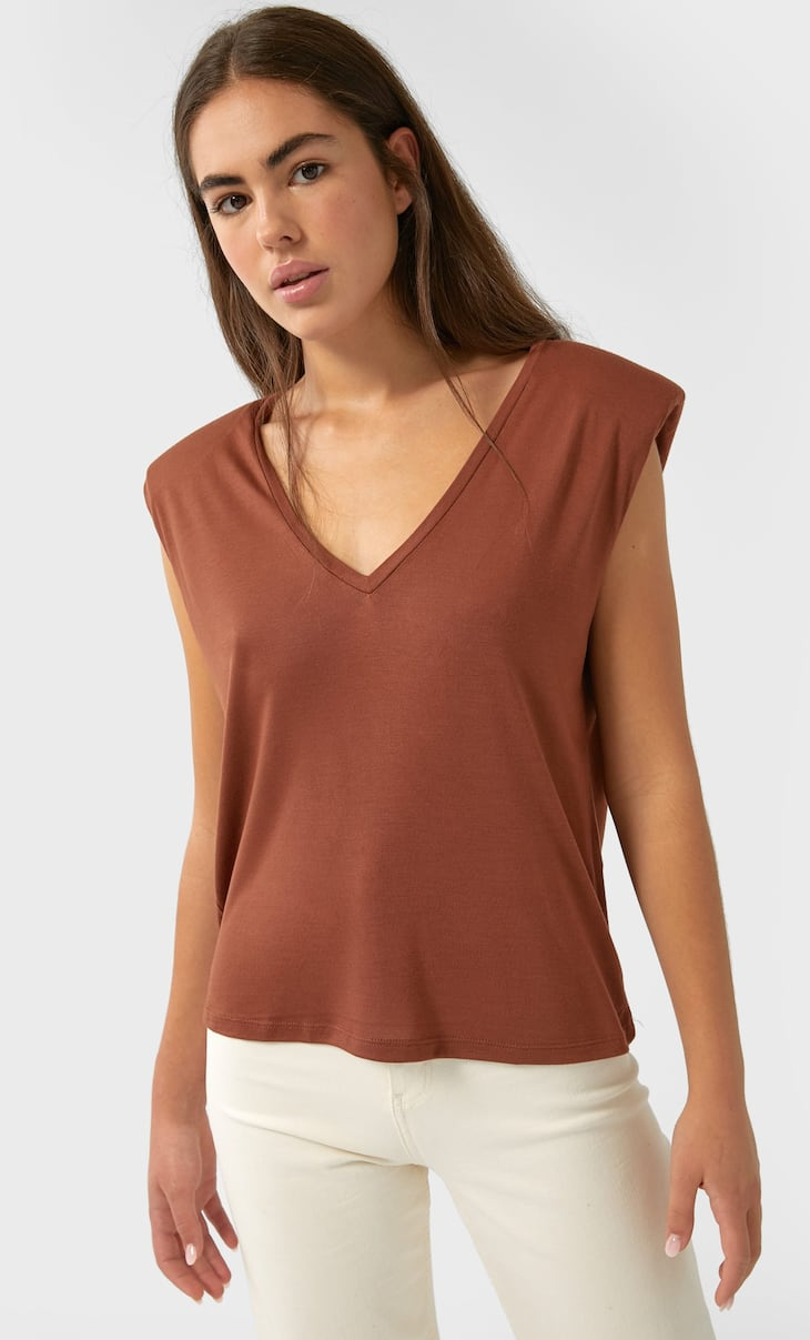 V-neck top with shoulder pads