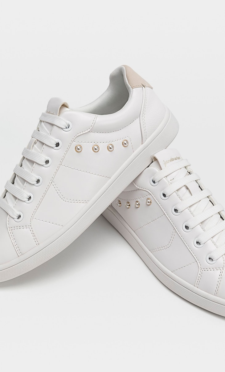 White trainers with faux pearls