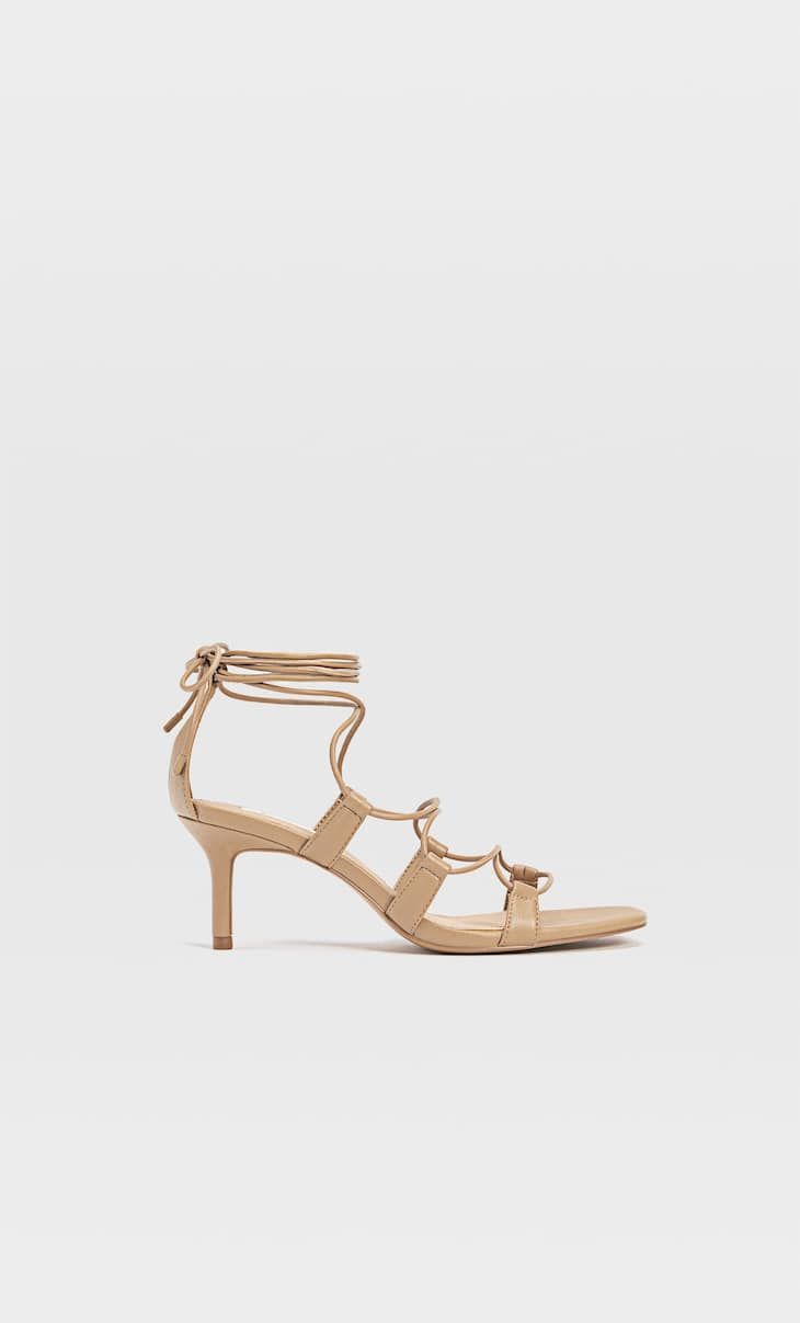 Heeled sandals with tied straps