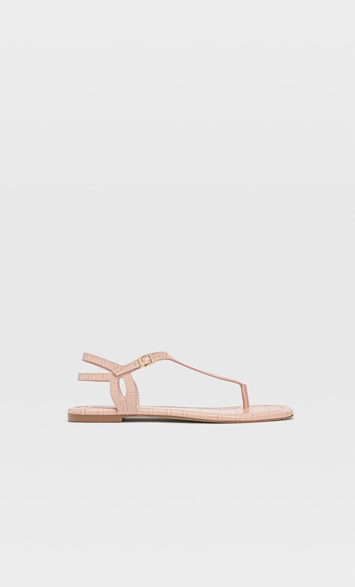 Flat sandals with embossed detail